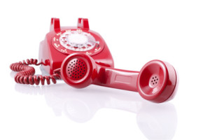 Vintage red rotary phone (with clipping path)
